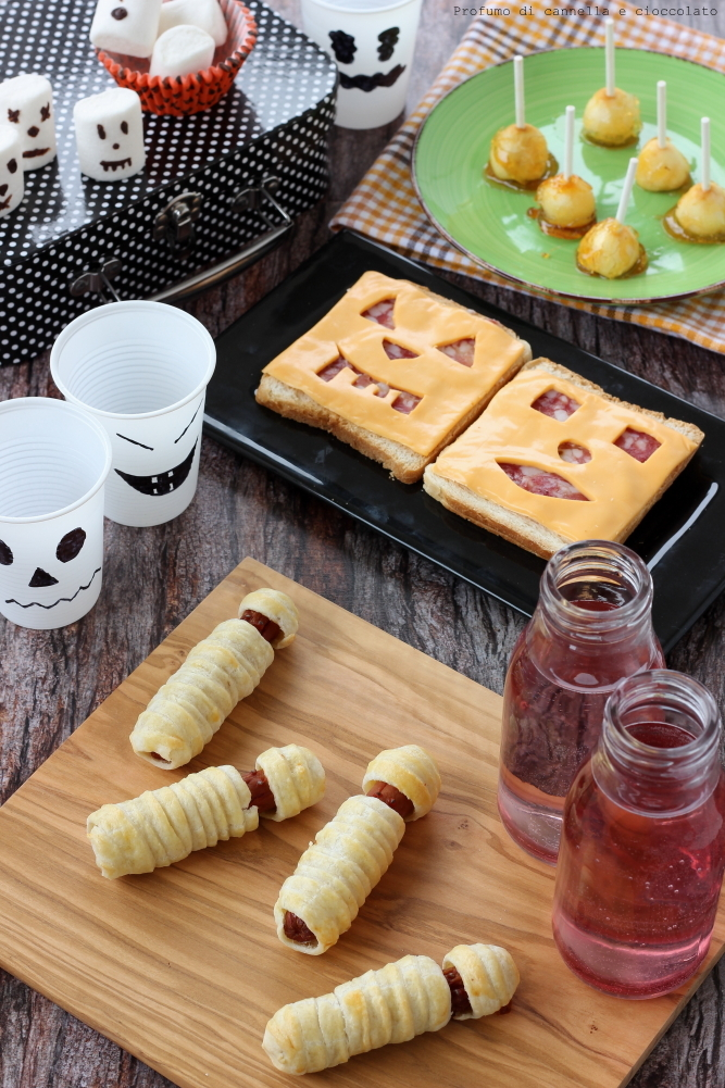 Halloween ideas: Mummy dog, Jack-o'-Lantern Sandwiches, Mele caramellate, Marshmallow fantasma